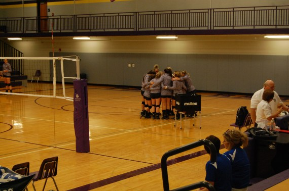 Paoli varsity volleyball team huddles up for a pep talk from coach Clark before the game.