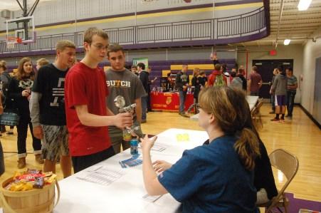 Freshman Ean Wilder tests his hand strength during the 2015 college fair.