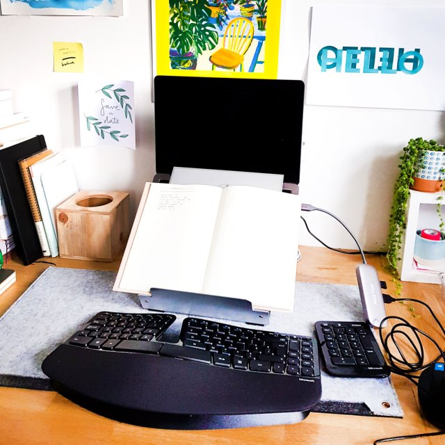 image shows ergonomic keyboard setup in workspace from disability services