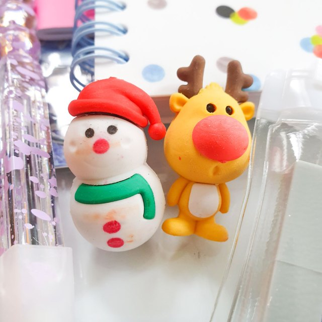 Snowman and reindeer erasers.