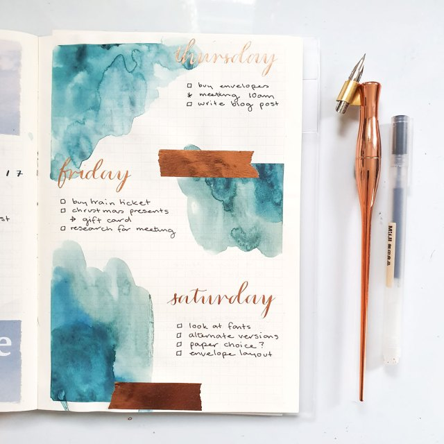 my favourite art supplies for bullet journaling includes calligraphy inks and watercolour paint