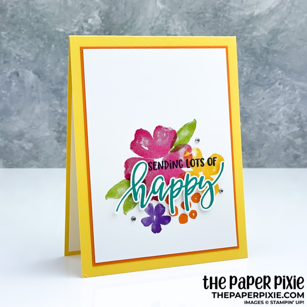 This is a handmade card stamped with the Pretty Perennials Stampin' Up! stamp set and the sentiment says sending you lots of happy.