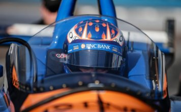 Scott Dixon sits in the No. 9 PNC Bank Honda on pit lane prior to the first oo-track test of the windscreen at ISM Raceway -- Photo by: Shawn Gritzmacher