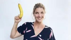Abbey holding a banana