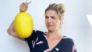 Abbey lifting up a honeydew melon