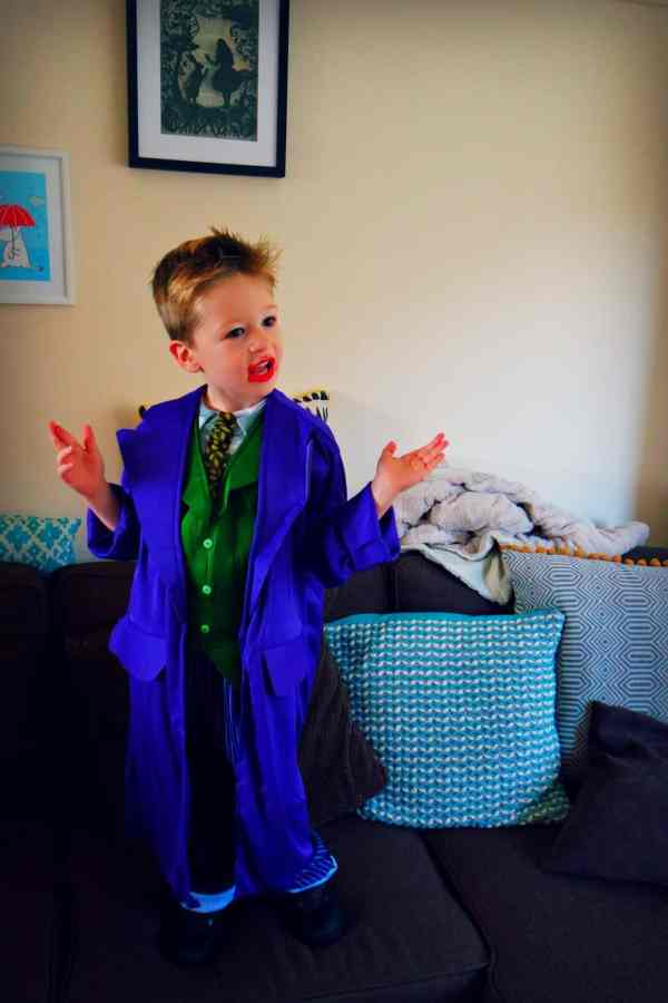 Little boy wearing blue Joker outfit with green waistcoat