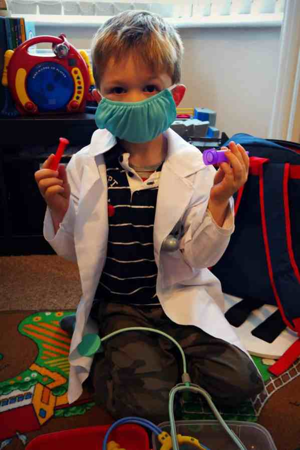 Little boy dressed up as a doctor