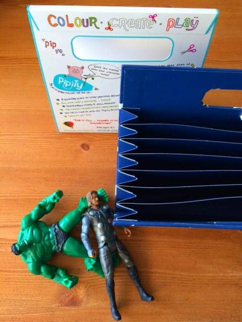 Action figures lying by blue activity case