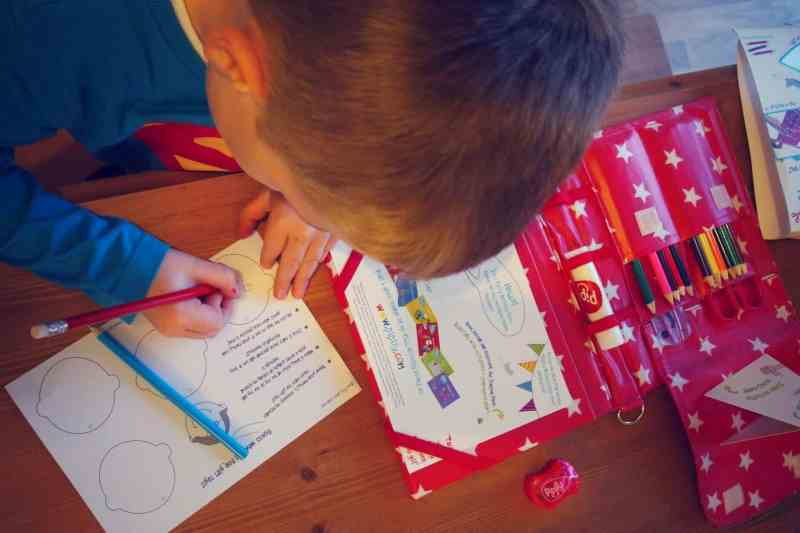 red crayons and drawing pad
