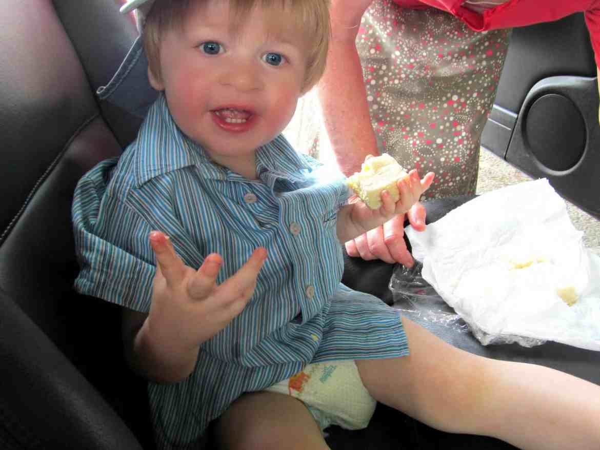 little boy pulling funny face with sticky hands