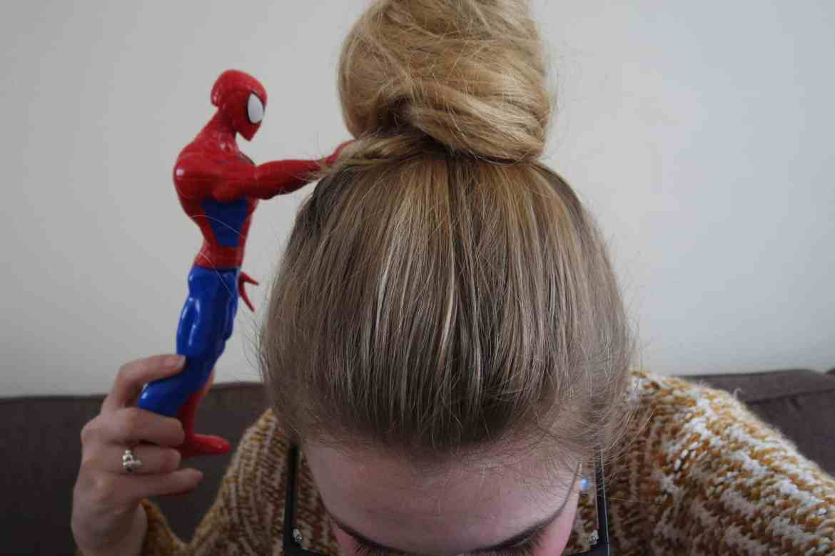 hair pun with spiderman poking it