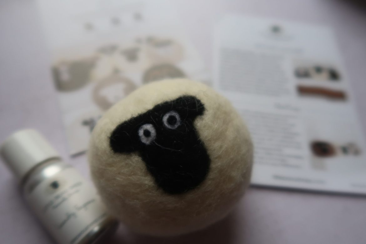 environmentally friendly living woolen ball with a black sheeps face