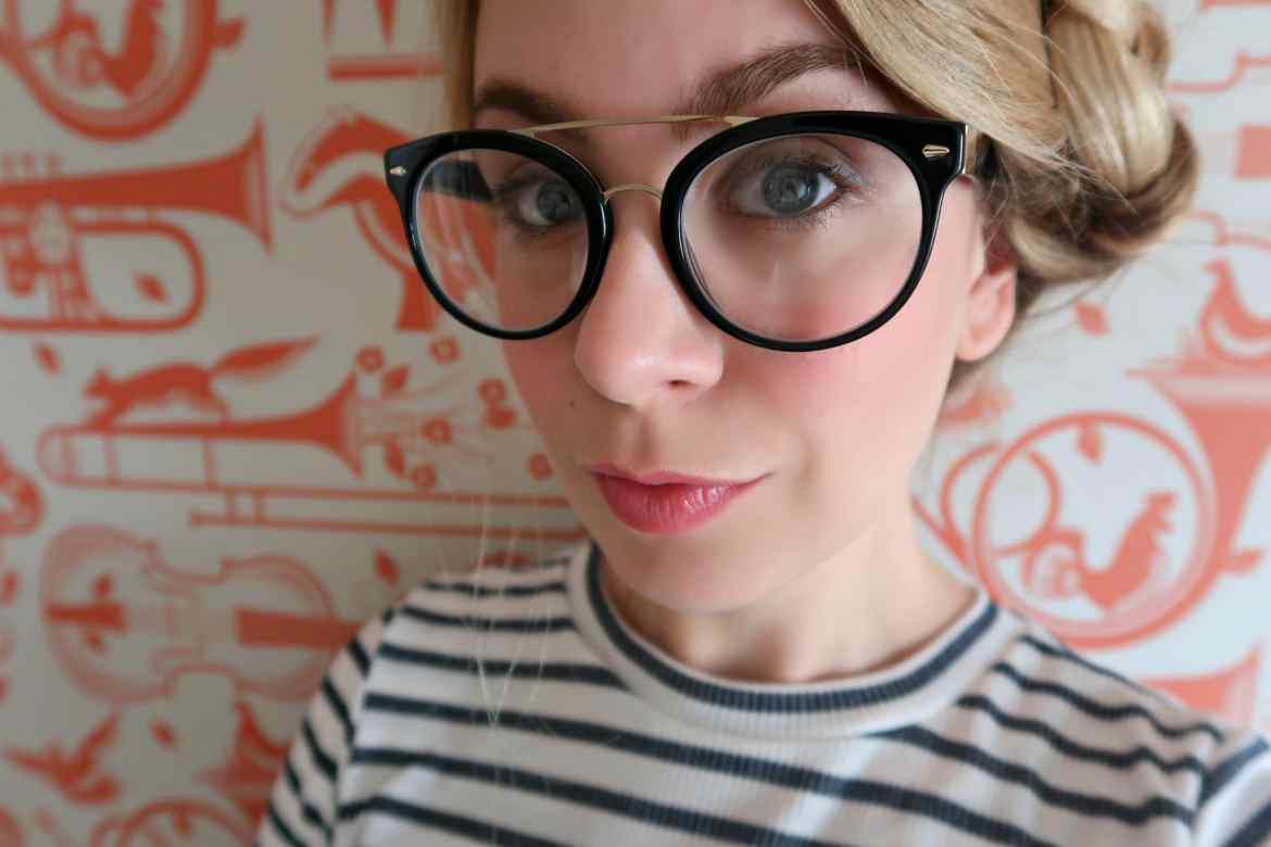 blonde lady wearing black Guildford iChoose frames