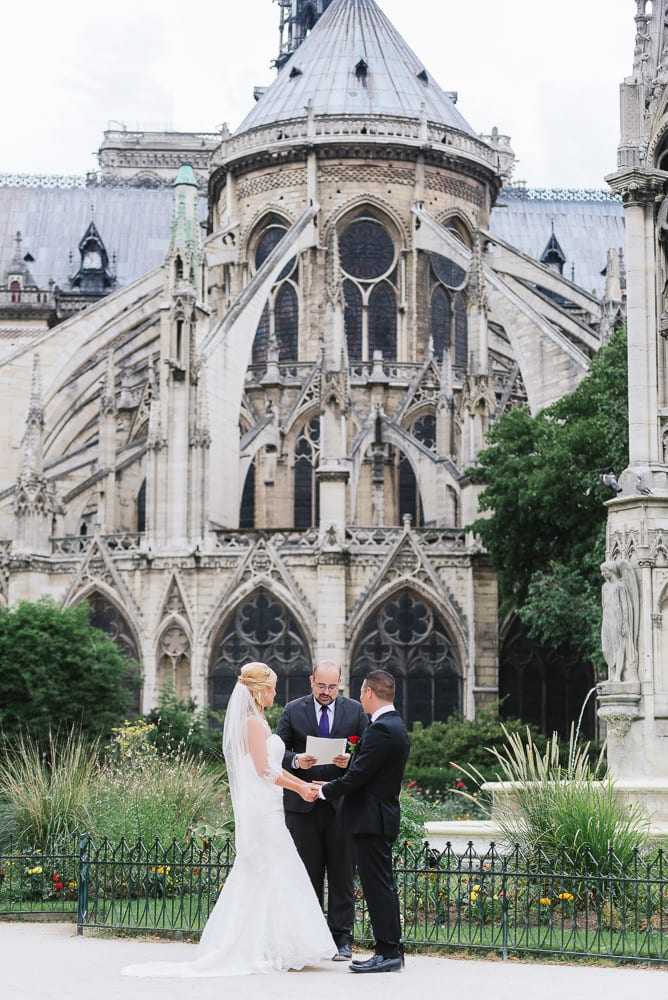Elopement in Paris behind the Notre Dame Cathedral in Square Jean XXIII