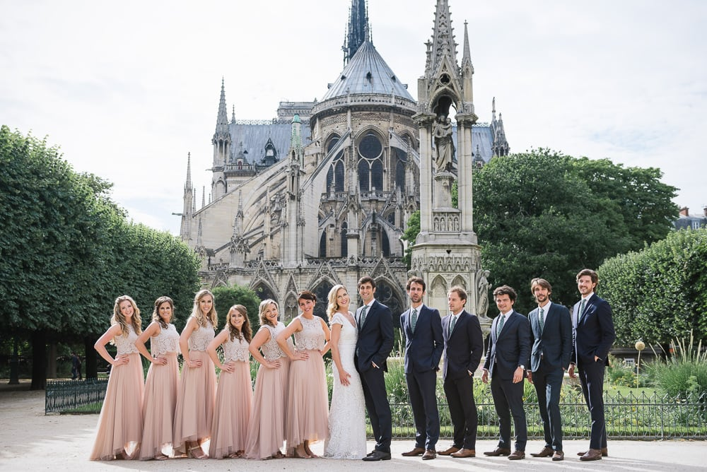 Paris elopement photographer - Bridal party and groomsmen at the Notre Dame cathedral