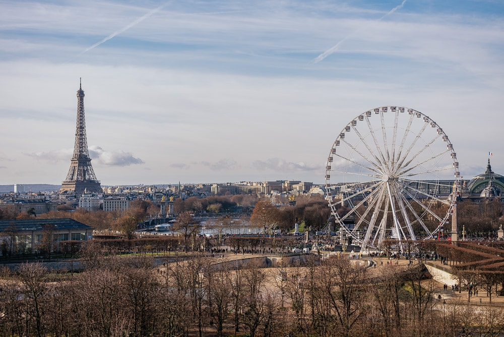 The view over the city of Paris from Le Meurice hotel - Eiffel Tower and the Ferris Wheel