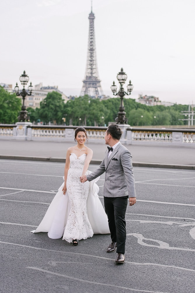 pre wedding pictures poses - bride and groom crossing the street in Paris -full