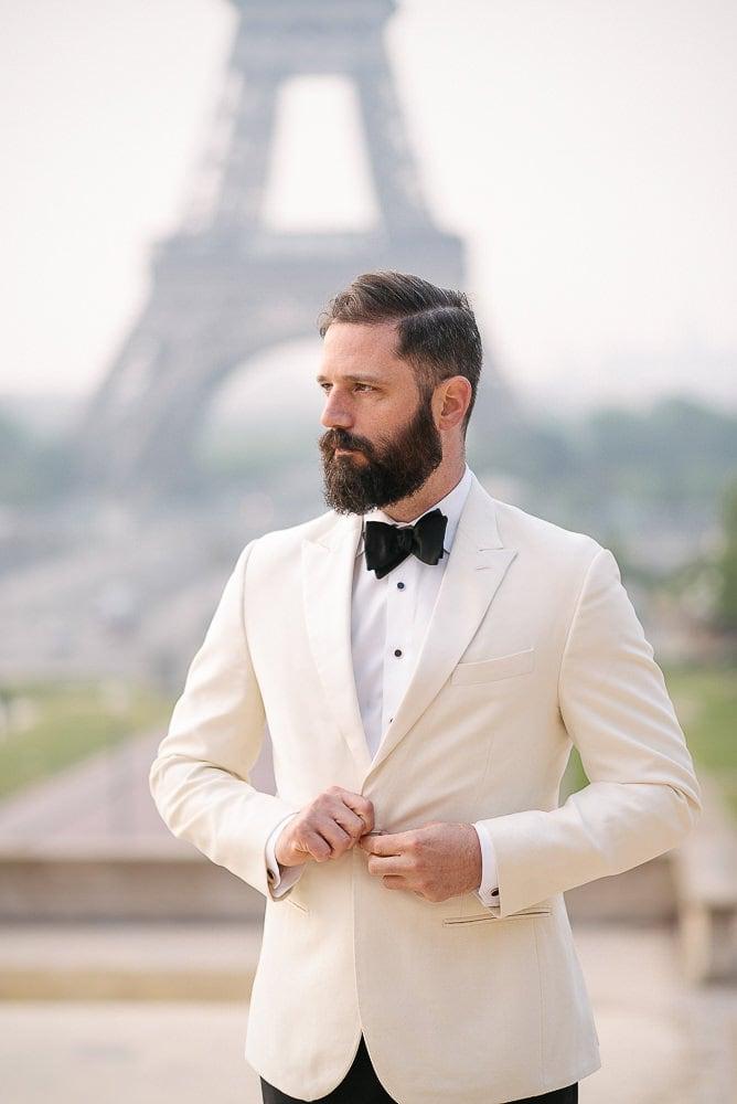 wedding photography paris - groom portrait by the eiffel tower