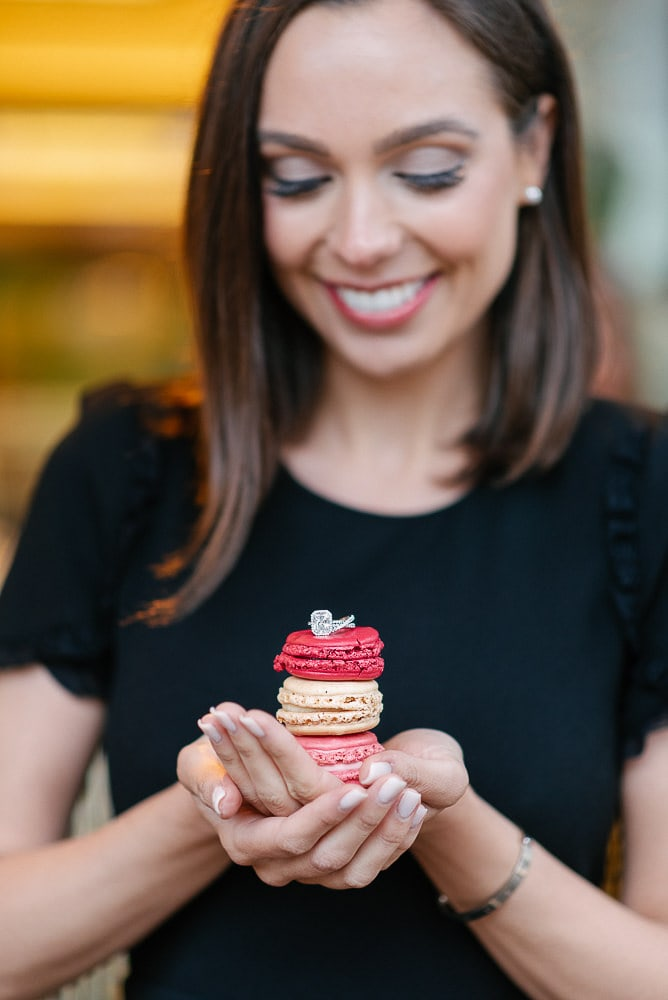 yes in paris and then engagement photos with diamond ring and macarons