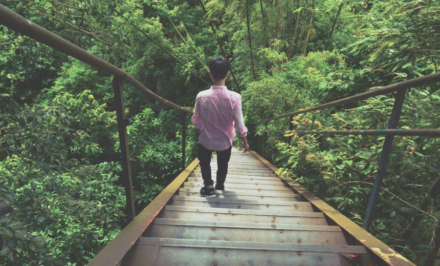 Fear: man walking on bridge