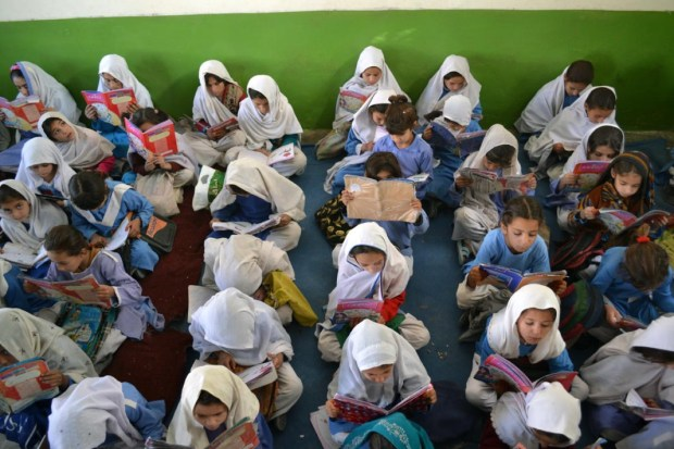 Girls are busy in reading the book during their class at Government girls Model High School in Pakistani border town Chaman. Photo by Matiullah Achakzai.