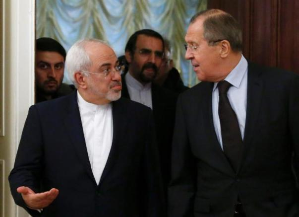 Russian Foreign Minister Sergei Lavrov (R) and his Iranian counterpart Mohammad Javad Zarif enter a hall during a meeting in Moscow, Russia, October 28, 2016. REUTERS/Sergei Karpukhin