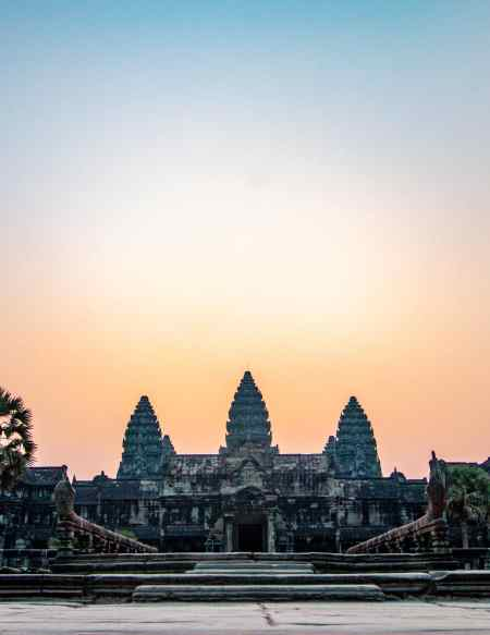 Angkor Wat towers with sunrising in background, no people