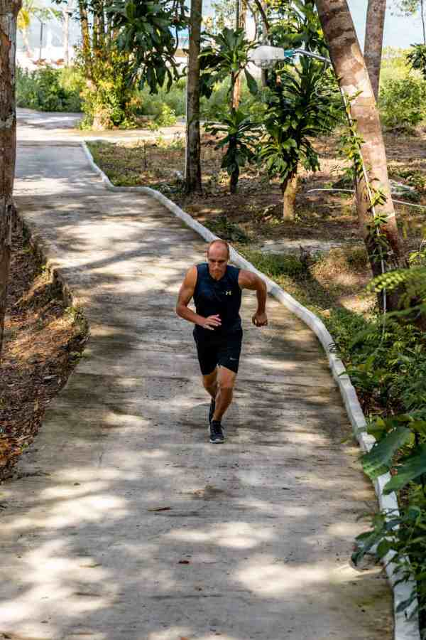 Nate running up hill in Koh Rong, Cambodia