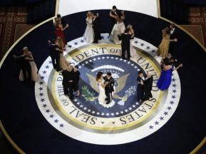 "President Donald Trump (center, L) and his wife Melania and family dance with U.S. military service members at the ""Salute to Our Armed Forces"" inaugural ball. REUTERS/Rick Wilking"