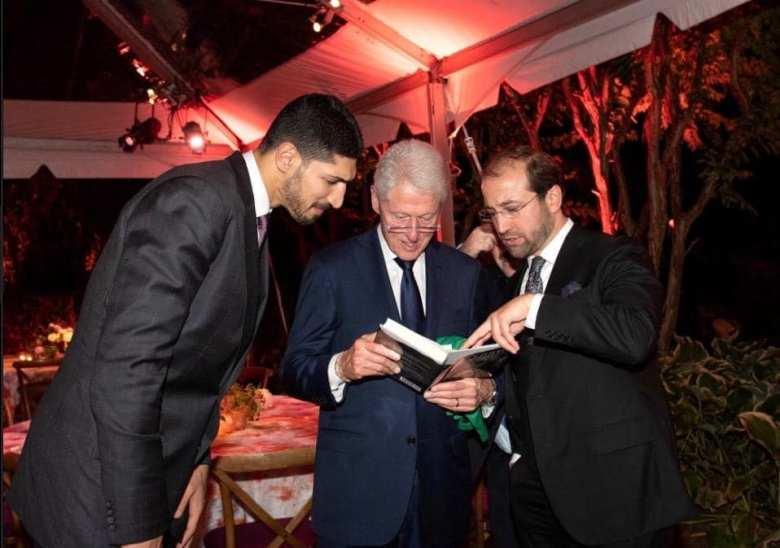 President Bill Clinton reading A Life Of Hizmet written by Fethullah Gülen