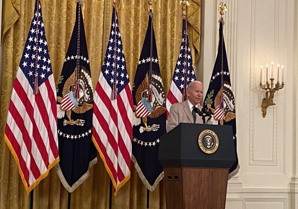 Joe Biden delivers jobs report wearing a tan suit.