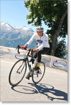 Robert Hess climbing the Alpe d'Huez on his bicycle