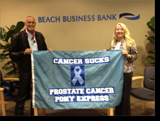 PCAP President Robert Hess and Board Member Melissa Lanfre at Beach Business Bank.