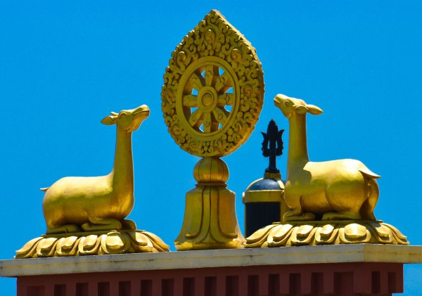 Photo 1. The Dharmachakra flanked by two deer is the symbol traditionally seen on all Tibetan monasteries