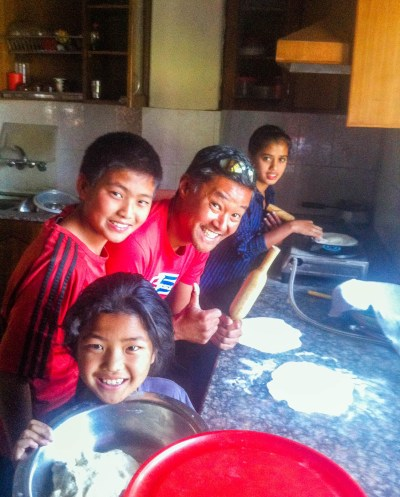 Photo 1. Being taught how to make chapatis at Sansar