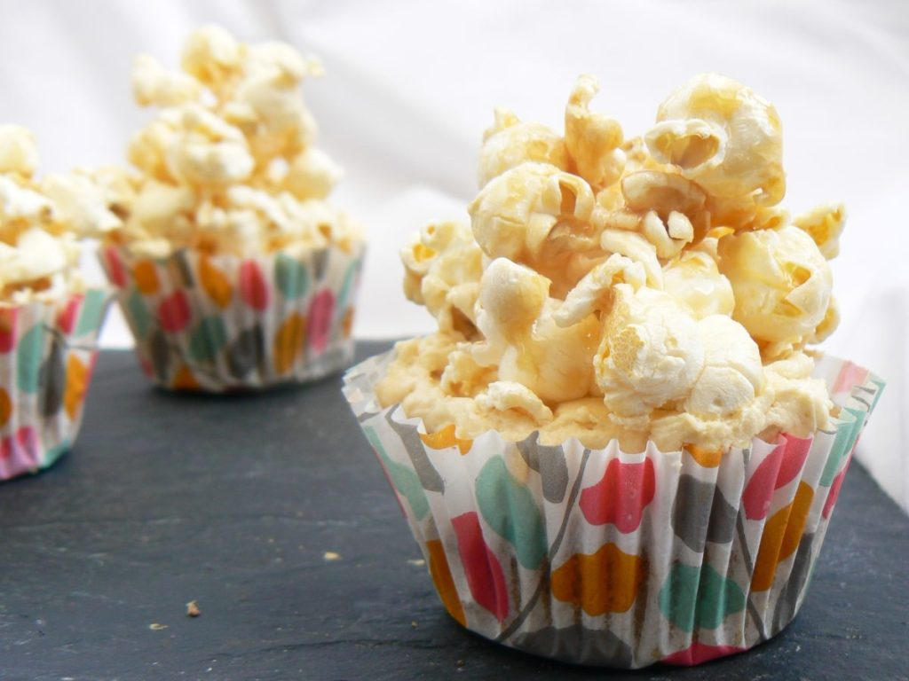 Vegan Salted Caramel Popcorn Cupcakes (Dairyfree, Eggfree). Caramel flavoured cupcake, topped with buttercream & piled high with homemade salty sweet popcorn!
