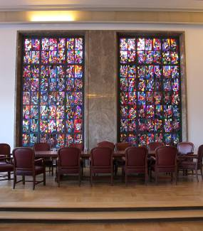 Historic hall featuring a stained glass window from 1932 by Adolf Hölzel