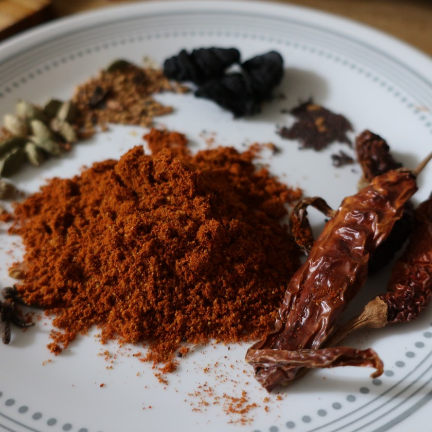 Image of curry powder, chilies, cardamom and Malabar tamarind