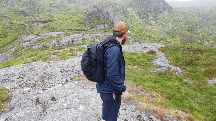 Attitude Supply ATD1 backpack on body side view hiking in Scotland