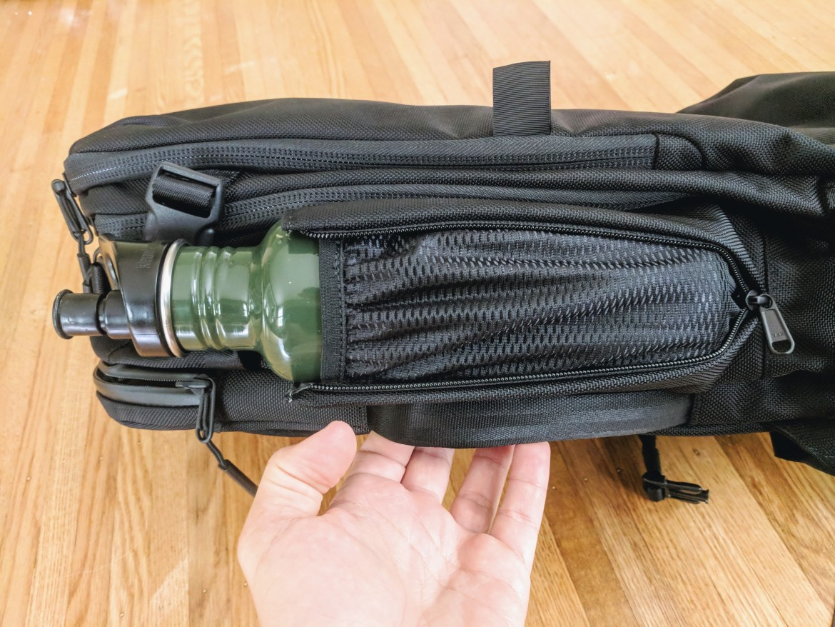 Aer Travel Pack 2 Water bottle holder zips up in use with Klean Kanteen