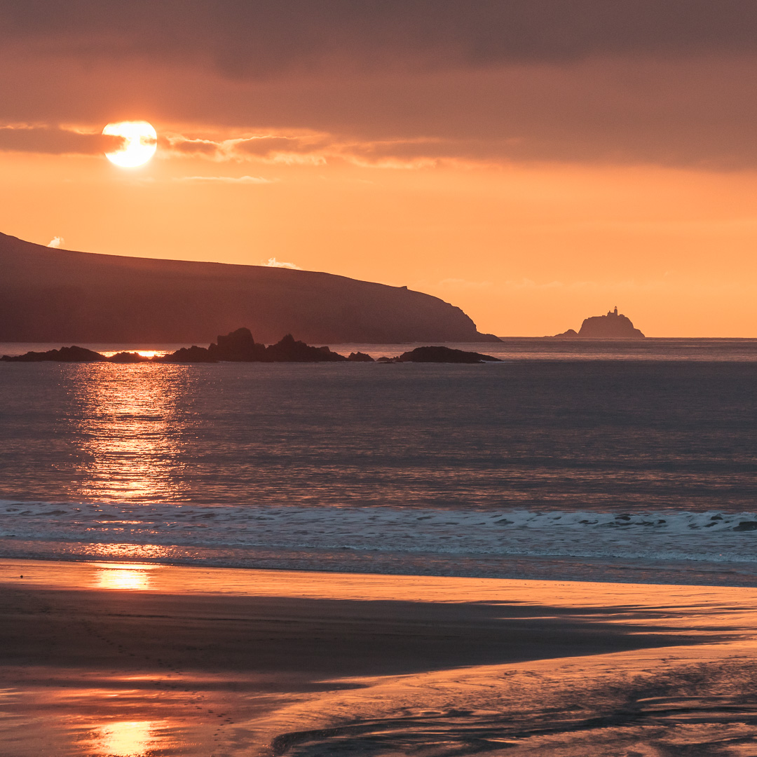 Sunset over Ramsey Island & South Bishop Lighthouse, Whitesands Bay, Pembrokeshire.