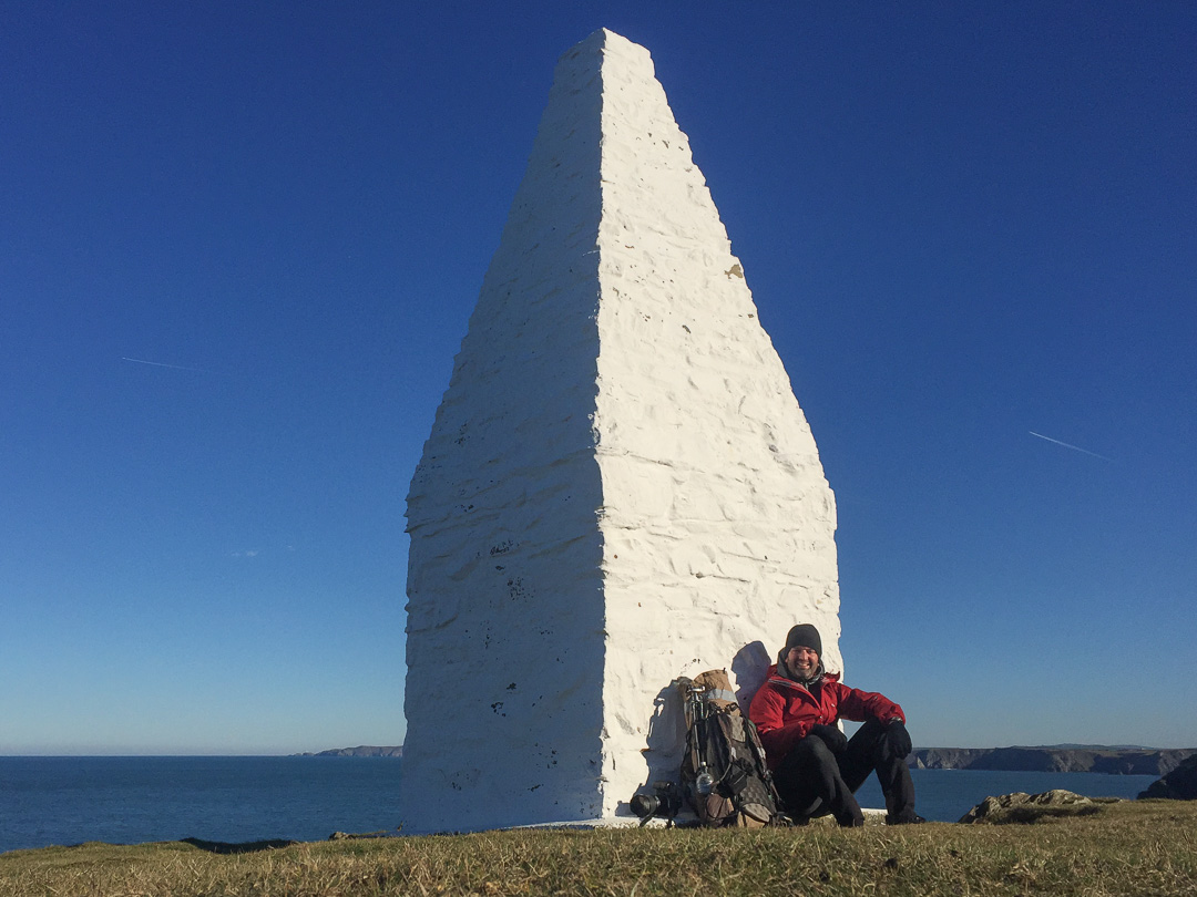 Enjoying the first sun for a while at Porthgain navigation beacon, Pembrokeshire.