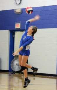 Victoria Hegstrom serves for the Jayettes this season. She earned volleyball Academic All-State honors.
