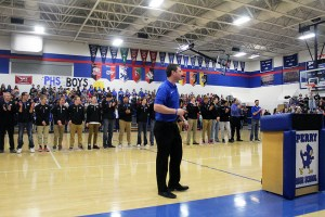 Perry head coach Ned Menke addresses the crowd as the Bluejay players applaud the support they have received during a pep rally Mar. 8.