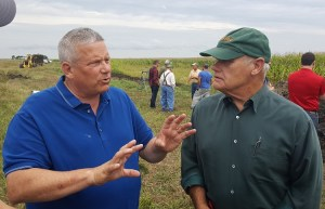 Iowa Department of Agriculture and Land Stewardship Secretary Bill Northey, left, talks with Dallas County Soil and Water District Commissioner Ray Harden and others at Friday's tour of the saturated buffer at the farm of Tom Vincent near Perry.