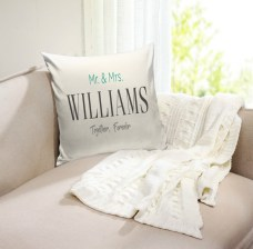 personalized throw pillow with a couples last name and some text