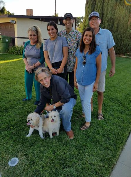 Warren with new family