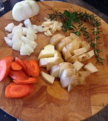 Chopped up carrots, potatoes, onion. garlic, and herbs