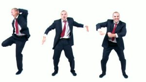 stock-footage-businessman-does-various-funny-dances-against-white-background