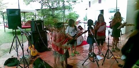 Tess ( far right in green dress ) and her merry band of little punks